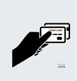 credit card in hand icon vector image