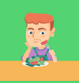 boy refusing to eat salad with healthy vegetables vector image vector image