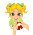 hands pins an award ribbon to chest of little girl vector image vector image