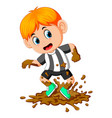 happy boy playing in the mud vector image