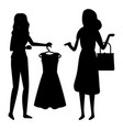 shopping woman in shop silhouette black and white vector image vector image
