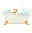 shiny ceramic bath on golden legs full of bubbles vector image