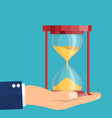 business hand holding a hourglass vector image vector image