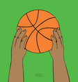 hands hold basketball ball on green background vector image vector image