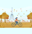 woman on bicycle in paris autumn fall vector image vector image