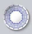 souvenir porcelain plate with a blue floral vector image vector image