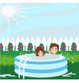 boy and girl playing in inflatable bapool vector image vector image
