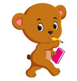 cute bear holding book and pencil vector image