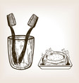 toothbrushes in glass and soap engraving vector image