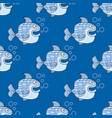 seamless pattern with blue fish on a blue vector image vector image