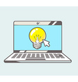 Blue laptop with yellow lightbulb on colo