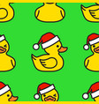 seamless pattern yellow rubber duck in santa hat vector image