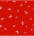silhouettes of deer on red background seamless vector image