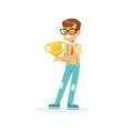 happy school boy holding winner cup kid vector image vector image