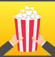 two human businessman hands holding big popcorn vector image vector image