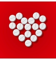 Pills in heart arrange on red background vector image vector image