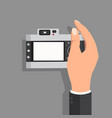 hand hold with camera vintage vector image