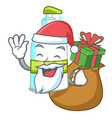 santa with gift liquid soap in cartoon shape vector image vector image