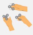 hands holding gray fidget spinner vector image