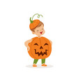 little boy dressed as a pumpkin cute kid in vector image vector image