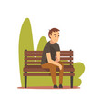 young man in casual clothes sitting on bench in vector image vector image