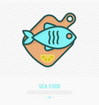 fish on wooden cutting board with lemon vector image vector image