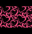 seamless pattern of pink hearts on a black vector image