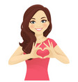 woman making heart shape with hands vector image vector image