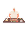 smiling chef cooking sushi at kitchen table vector image