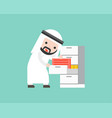 arab businessman finding document files in drawer vector image vector image