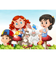 Three girls and rabbits in the garden vector image