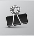 black binder clip on grey background vector image