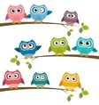 Set of colorful cartoon owls on branches vector image vector image