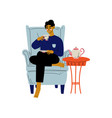 young man sitting in armchair with cup coffee vector image vector image