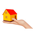 hand with house vector image