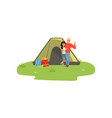 happy couple camping in nature with fire in front vector image vector image