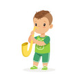 cute little boy playing trumpet young musician vector image vector image