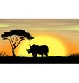 Rhinoceros under a tree vector image vector image