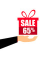 gift box on the hand with a 65 percent discount vector image vector image