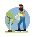 man watering the tree vector image