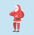 man wearing santa claus costume holding huge red vector image vector image