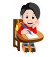 happy schoolboy writing in class vector image