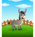 happy donkey cartoon on the field vector image vector image