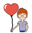 Man with glasses and heart balloon in the hand