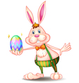 A rabbit holding an easter egg vector image vector image