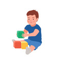 cute smiling child playing with colorful cubes vector image vector image