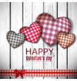 Red cloth handmade hearts on wooden background vector | Price: 1 Credit (USD $1)