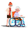 nurse carrying a disabled old woman in wheelchair vector image