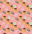 Seamless background with a pattern of donuts vector image