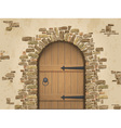 Arch of stone with closed wooden door vector image vector image